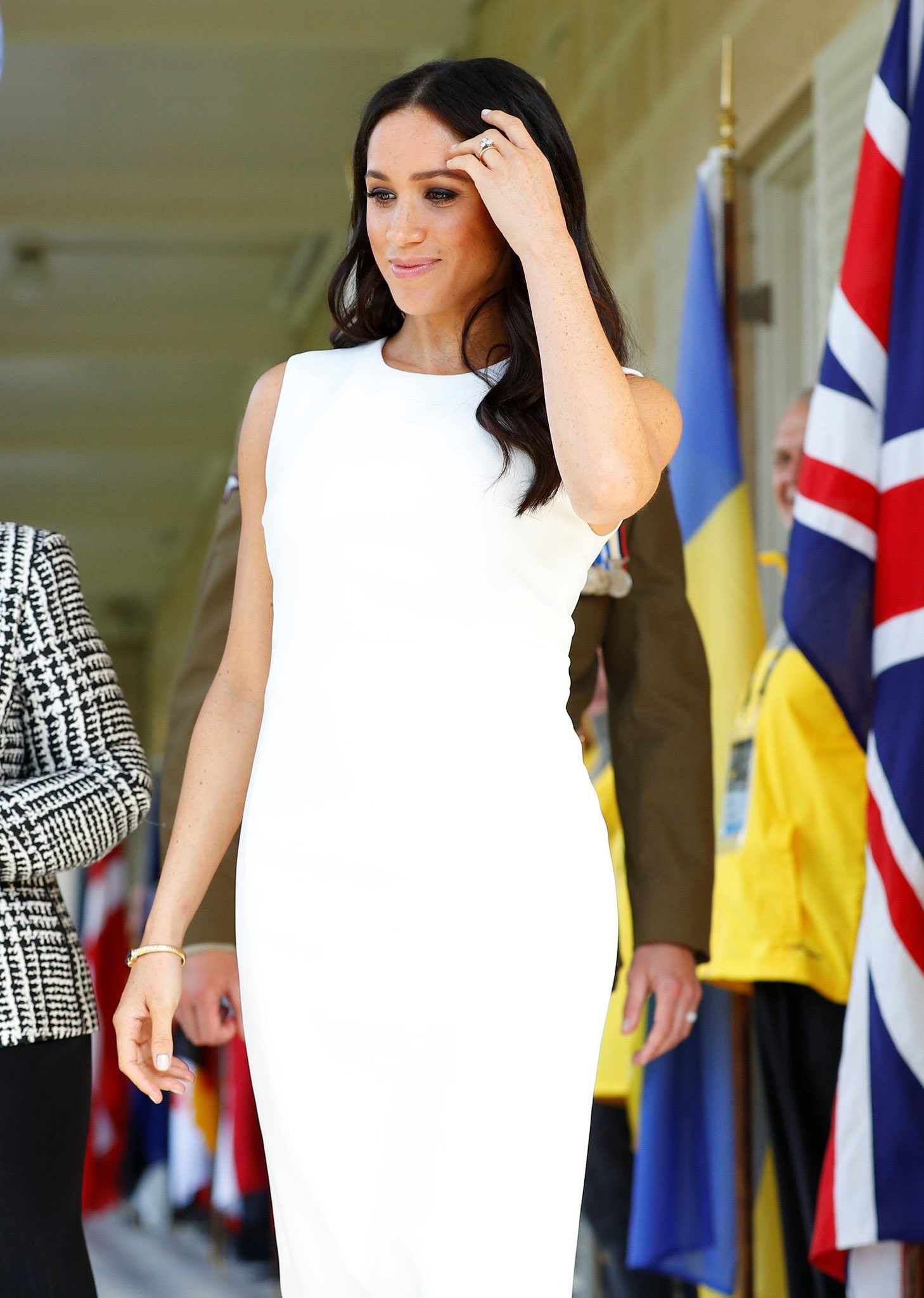 96aef483b53f The most significant part of Meghan s outfit was her jewelry – butterfly  stud earrings and a coordinating bangle
