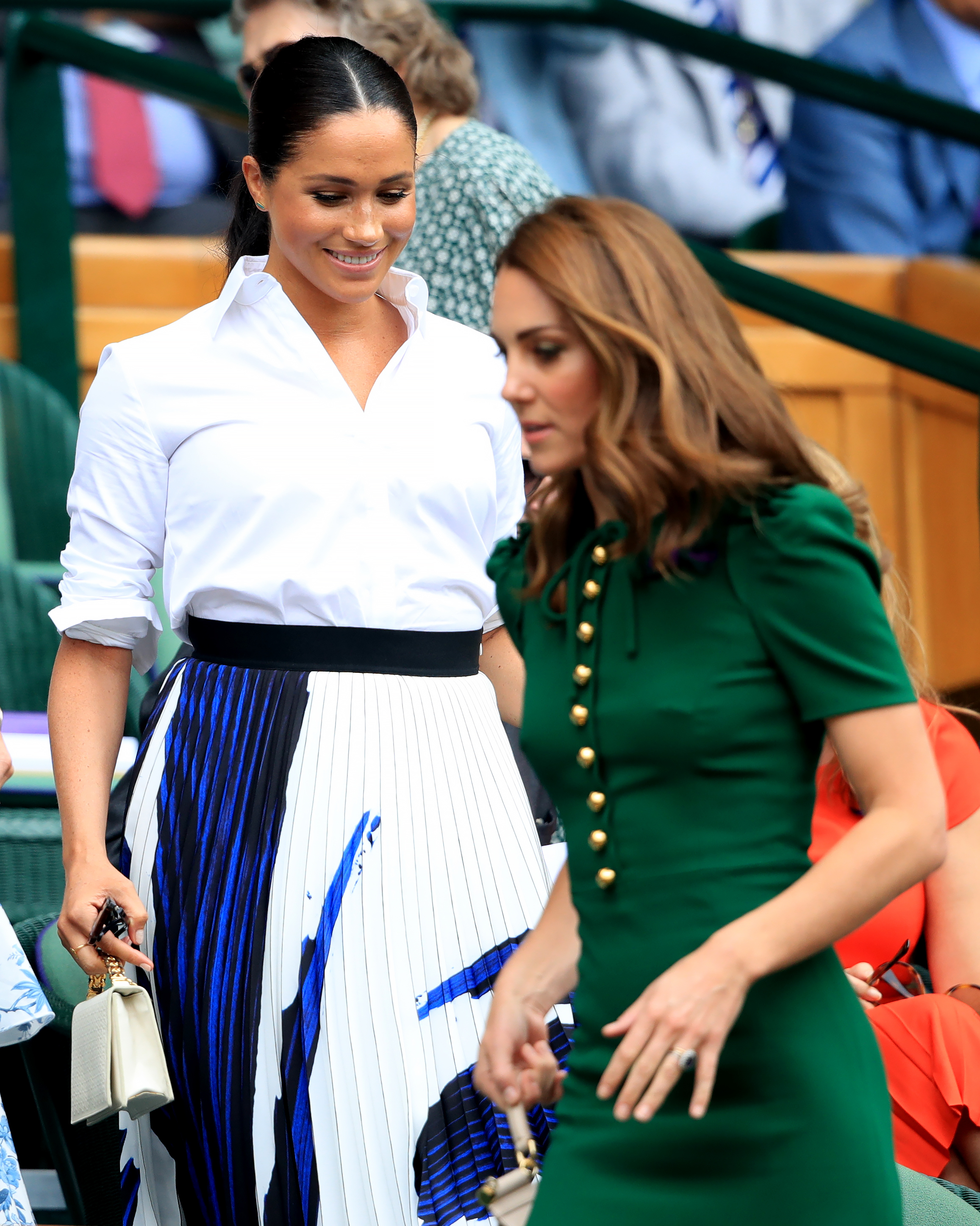 The Duchess of Cambridge and The Duchess of Sussex on day twelve of the Wimbledon Championships at the All England Lawn Tennis and Croquet Club, Wimbledon.